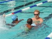 swim instructor with two students in the pool