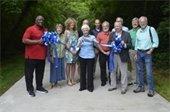 Mayor Nancy Denson with group of dignitaries cutting the ribbon at Trail Creek Greenway