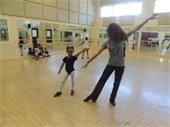 Two dancers in a dance studio