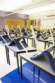 classroom chairs on top of tables