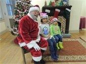 children sitting with Santa Claus
