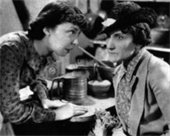 Black and white image of ladies talking to one another