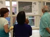 Group of people looking at park drawings