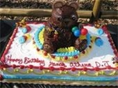 Birthday cake with a bear decoration on top