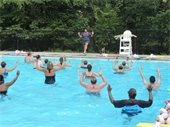 Instructor teaching a water aerobics class at the pool