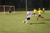 Adult men playing soccer