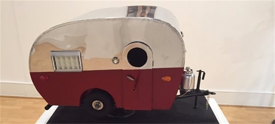 birdhouse made to resemble camping trailer