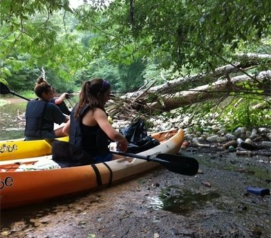 Stormwater Interns Courtney and Rosemary clean up part of the North Oconee River.
