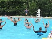 Instructor teaching participants in aqua aerobics