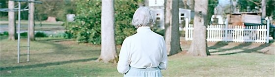 Picture of elderly woman from behind