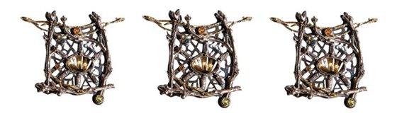 Intricate metal bird's nest pieces