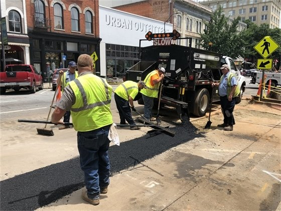 Crews Spreading Temporary Asphalt to Re-Open the Street