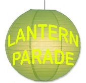 """green paper lantern with the words """"Lantern Parade"""" on it"""