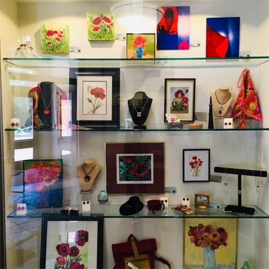 Display case featuring hand made items for sale