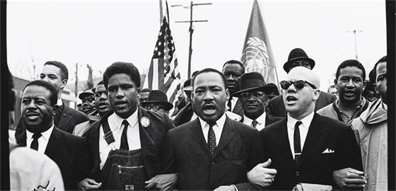 Black and white photograph of MLK, Jr. and others