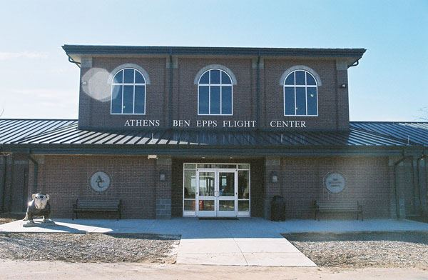 The exterior of the Athens Ben Epps Flight Center. Brick building with a bulldog out front.