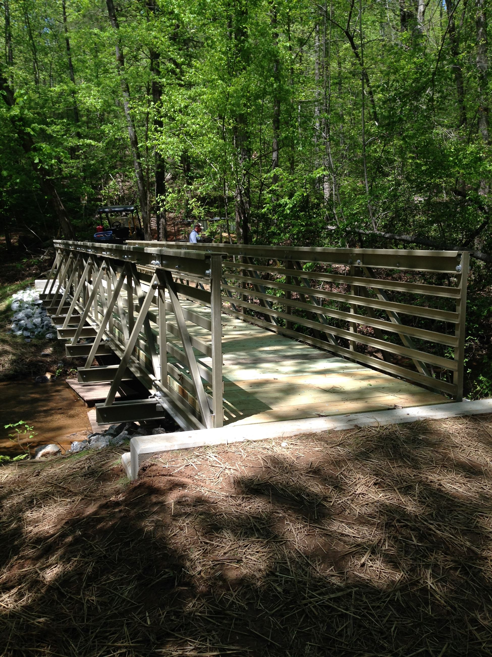 Photo of the completed replacement of Bridge #4 on Lakeside Trail at Sandy Creek Park.