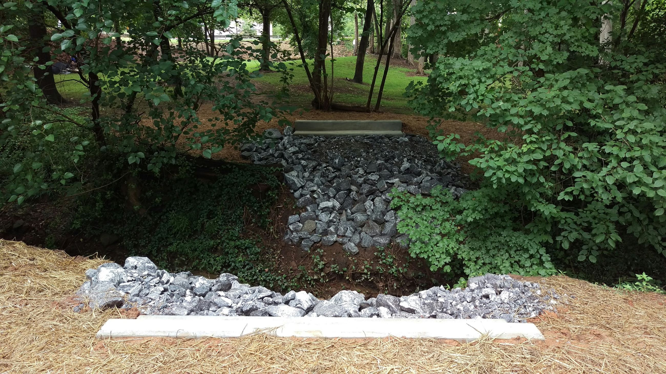 Photo of the completed abutments for the replacement pedestrian bridge at North Oconee River Park.