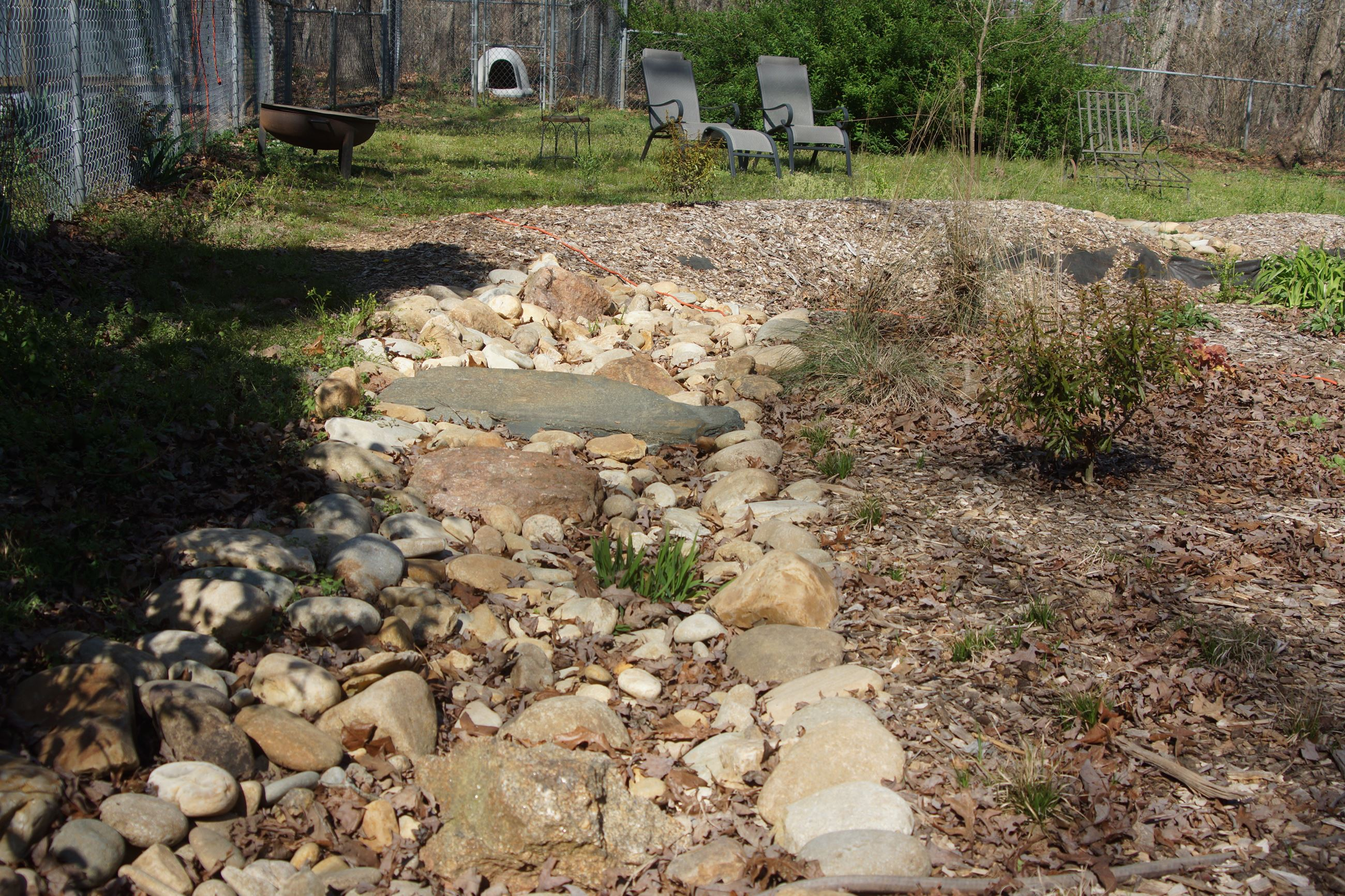 Dry creek bed that leads to a rain garden