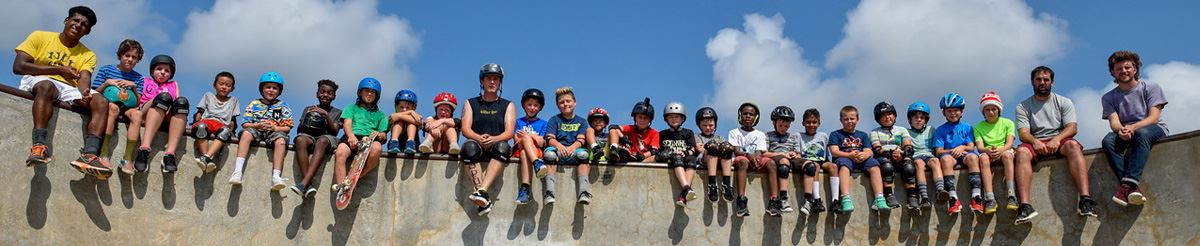 Skate Camp participants sitting on the side of the bowl