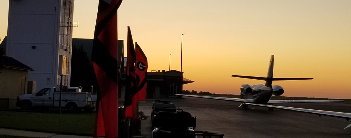 University of Georgia gameday at sunset with jet in the foreground
