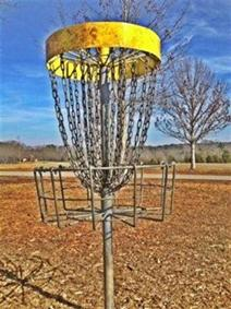 A typical disc golf basket.