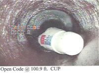 A fast food cup clogging a sewer pipe