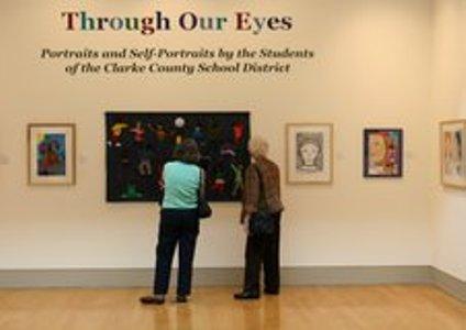 Visitors looking at art